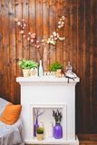 Cozy home interior, clock, vase with flowers, toy bear, sofa Royalty Free Stock Image