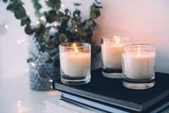 Cozy home interior decor, burning candles. In evening room stock photo
