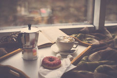 Cozy home winter with coffee and blanket. Hipster style filtered Stock Photo