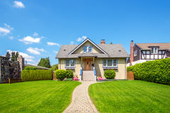 Cozy house with beautiful landscaping. On a sunny day. Home exterior Stock Photos