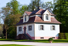 A cozy house in a beautiful park. Royalty Free Stock Photography