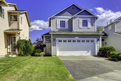Cozy house exterior with garage Royalty Free Stock Photography