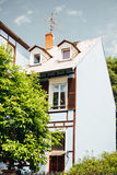 Cozy house facade on a warm day Royalty Free Stock Image