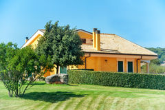 Cozy house with garden Royalty Free Stock Photography