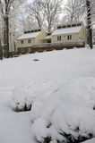 Cozy House on Snow Covered Hill. A cozy house atop a snow covered hill with snow covered trees Royalty Free Stock Images