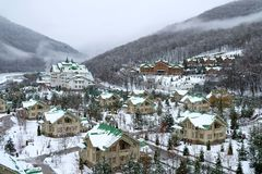 Cozy houses in snowy mountains. Krasnaya Polyana Stock Image