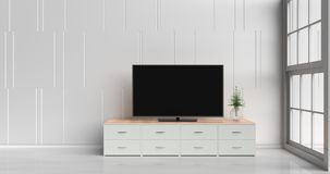 Cozy interior room design. Smart tv on tv stand  in white living room decorated with wood white tv stand, tree in glass vase, white cement wall it is grid Royalty Free Stock Image