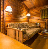 Cozy interior of a rustic log cabin.  Royalty Free Stock Photography