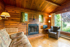 Cozy interior of a rustic log cabin Stock Photography