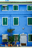 Cozy Italian house with blue front Royalty Free Stock Image