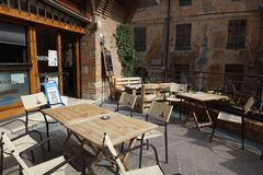 A cozy Italian open-air cafe in the historic part of the city of Bertinoro. royalty free stock photo