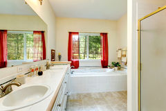 Cozy ivory bathroom with french window Royalty Free Stock Photography