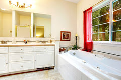 Cozy ivory bathroom with a french window Stock Images