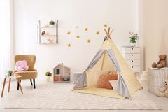 Cozy kids room interior with play tent. And toys royalty free stock images