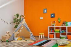 Cozy kids room interior with play tent. And toys royalty free stock photo