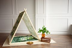 Cozy kids room interior with play tent and toys. stock photo