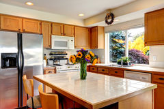 Cozy kitchen interior with island and window Stock Image
