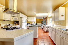 Cozy kitchen room with white cabinets Royalty Free Stock Photography
