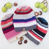 Cozy knitted children set of hats. Cute cozy knitted children set hats with chestnuts Stock Images