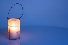 Cozy lantern on blue winter background Stock Images