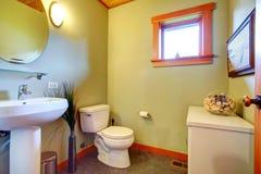 Cozy light olive bathroom Stock Image