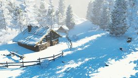 Cozy little hut in a snowy mountains at daytime Royalty Free Stock Image