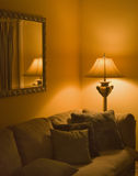 Cozy living room. Corner with couch and lamp Royalty Free Stock Photos