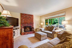 Cozy living room with brick fireplace Royalty Free Stock Image