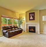 Cozy living room with carpet, and fireplace. Stock Image