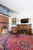 Cozy living room with fireplace Royalty Free Stock Photography