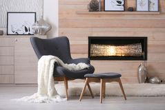 Cozy living room interior with comfortable furniture. And decorative fireplace stock photo