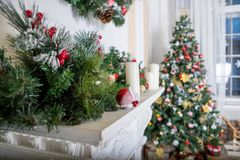 A cozy living room lighted with numerous lights decorated ready to celebrate Christmas. Christmas room interior design royalty free stock photos