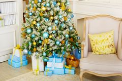 A cozy living room lighted with numerous lights decorated ready to celebrate Christmas. Christmas room interior design stock images
