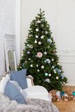 Cozy living room with sofa and decorated Christmas tree Royalty Free Stock Image