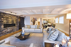 Cozy living room with a stone wall Stock Photography
