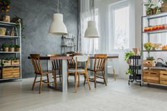 Cozy loft with dinning table Royalty Free Stock Photography