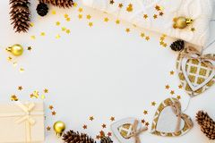 Cozy magical Christmas background for writing on white with cones, sweater, stars and decor. Top view. stock photo