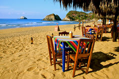 Cozy mexican beach restaurant. Beach restaurant with colorful handcrafted tableclothes. Zipolite, Oaxaca, Mexico Royalty Free Stock Photos