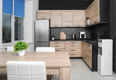 Cozy modern kitchen interior with new furniture. And appliances royalty free stock photography
