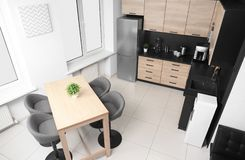 Cozy modern kitchen interior with new furniture stock photography
