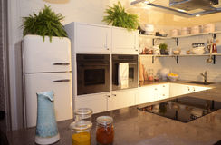 Cozy Modern White Kitchen - Chef Work Place Stock Image
