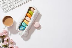 Cozy morning breakfast with pastel colorful macarons or macaroon. S Stock Image