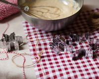Cozy morning, family time, cooking in progress. Dough in a metal bowl, mixer, metal molds, rope for deciration, red and white tablecloth royalty free stock images