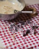 Cozy morning, family time, cooking in progress. Dough in a metal bowl, mixer, metal molds, rope for deciration, red and white tablecloth royalty free stock image