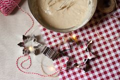 Cozy morning, family time, cooking in progress. Dough in a metal bowl, mixer, metal molds, rope for deciration, red and white tablecloth stock photography