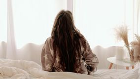 Cozy morning healthy comfortable rest teenage girl. Cozy morning. Healthy comfortable rest. Teenage girl in pajamas waking up leaving bed stock video footage