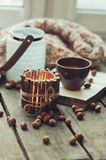 Cozy morning at home with handmade wooden candleholder and coffee, selective focus Royalty Free Stock Images