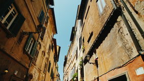 A cozy narrow street in the old historical part of Rome.. Steadicam wide lens shot stock video