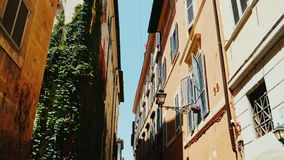 A cozy narrow street in the old historical part of Rome. Steadicam wide lens shot stock footage