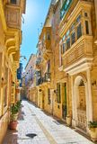 Lazy walk in Birgu, Malta. The cozy narrow streets of residential quarters are perfect place for lazy daily walks, enjoying traditional architecture, Birgu stock photography